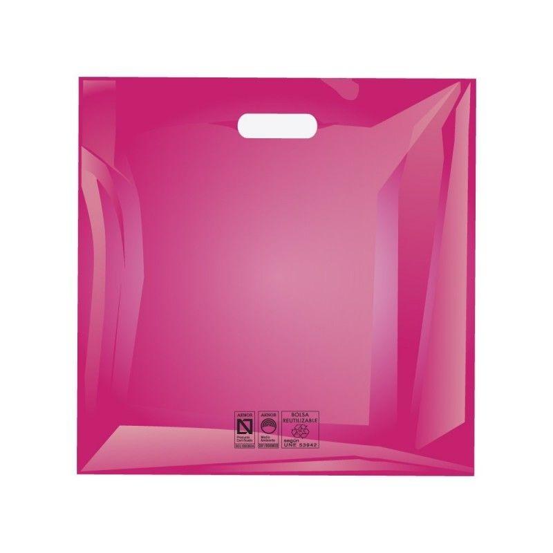 Bolsas de plástico reciclado color rosa fucsia con asa de troquel y fabricada con un grosor de 220 galgas o 55 micras