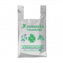 Bolsa de plástico reciclado gris para farmacia con una medida de 40/26x50 centímetros, contiene un 70% de material reciclado.